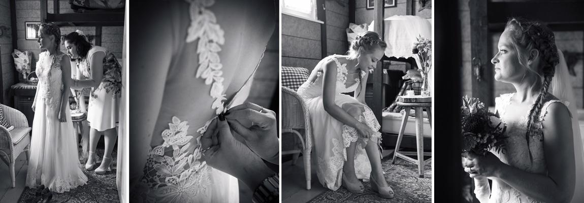 Braut beim anziehen ihres Hochzeitskleides